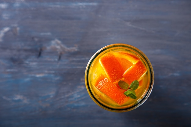 Detox infused water with orange. summer party drink.