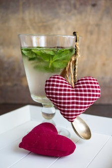 Detox mint drink and heart shaped decor as a drink concept for st. valentine celebration