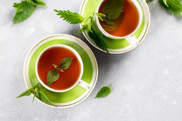 Detox tea of fresh nettles on the table