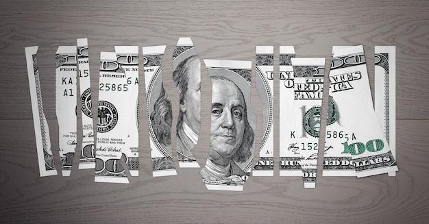 Понятие обесцененного доллара. измельчите долларовую купюру на деревянном столе. 3d рендеринг