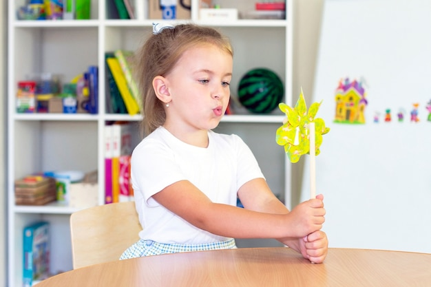 Developmental and speech therapy classes with a child-girl.