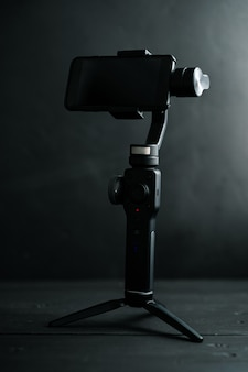 A device for image stabilization when taking photos and videos on a smartphone on a black background