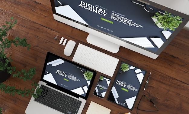 Коллекция устройств с видом сверху 3d-рендеринга с веб-сайтом цифрового агентства на экране