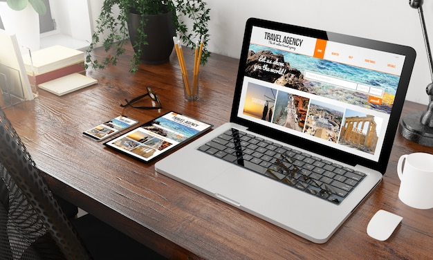 Devices travel agency on wooden desktop