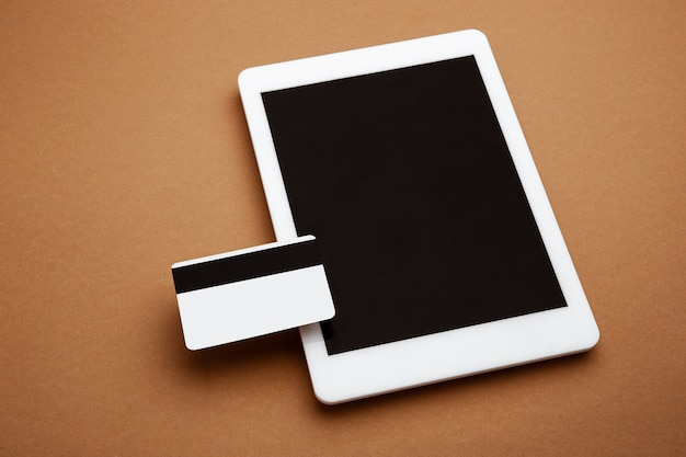 Devices with blank screens floating above brown background phone tablet card