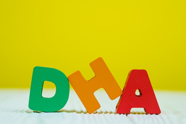 Dha text alphabet on yellow wall background