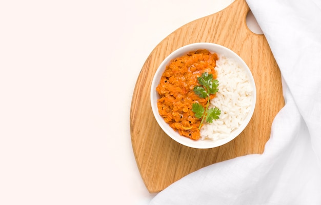 Dhal indian lentil soup in a bowl on a wooden plank Premium Photo