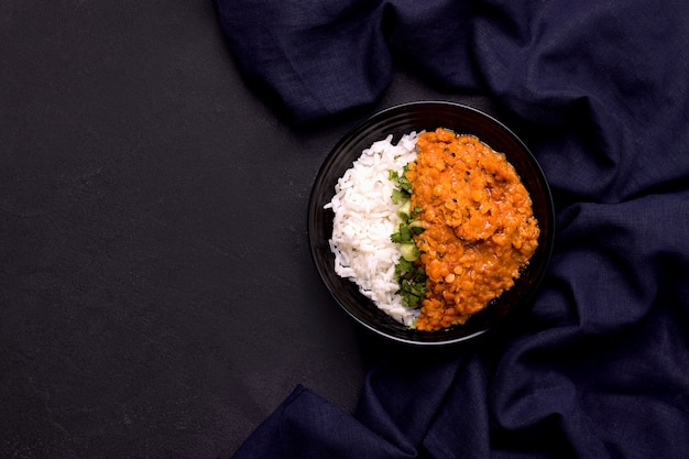 Dhal indian lentil soup with rice on black Premium Photo