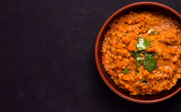 Dhal indian vegetarian lentil bean soup in minsk with herbs close-up