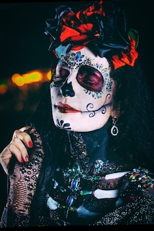 Dia de los muertos close-up portrait of a young woman Free Photo