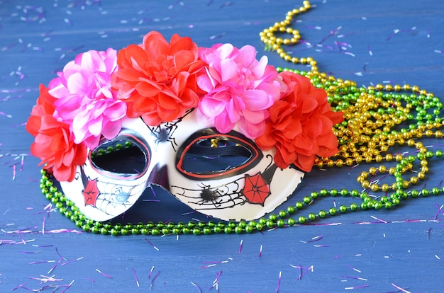 Dia de los muertos mask on a wooden table. halloween carnival accessories. day of the dead masquerade holiday concept.