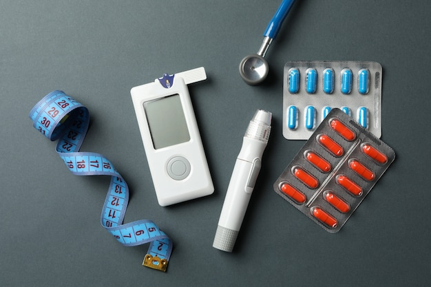 Diabetes accessories on black background, top view