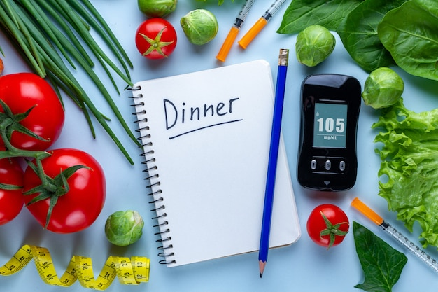 Diabetes concept. balanced, clean food for healthy lifestyle of diabetic patient. diabetes diet plan and control diary. monitoring glucose levels