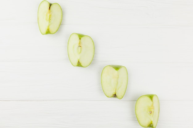 Diagonal of apples slices on white background
