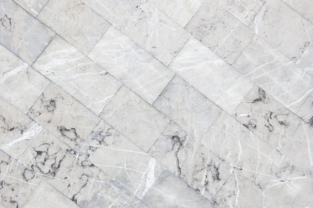 Diagonal checkerboard design of gray marble floor tiles used as the back panel