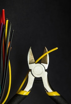Diagonal cutters and yellow wire close up