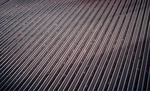 Diagonal metallic surface illuminated by light rays texture background