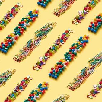 Diagonal multicolored collection of stationery strips paperclips and pins
