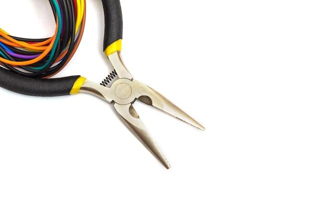 Diagonal pliers and wires closeup on white backgroun