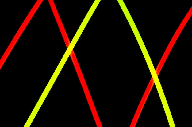 Diagonal red and yellow neon lines design on black background