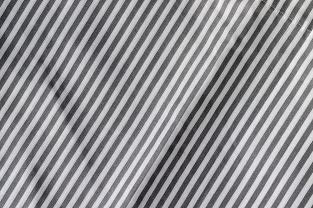 대각선 스트라이프 패브릭 질감. 흰색과 회색 직물 배경