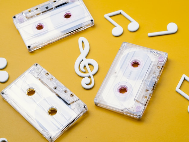 Diagonal view white cassette tapes with musical notes around