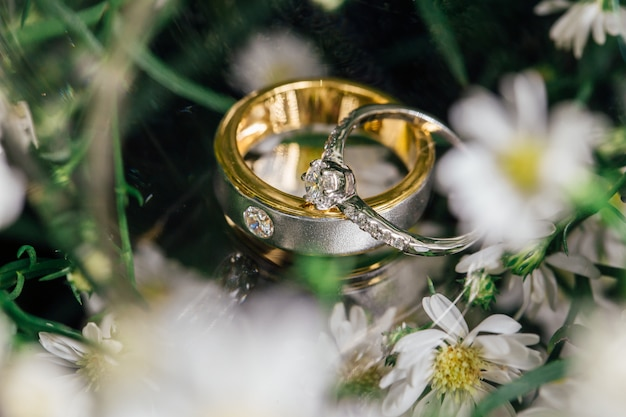 The diamond couple wedding rings is placed on glass.