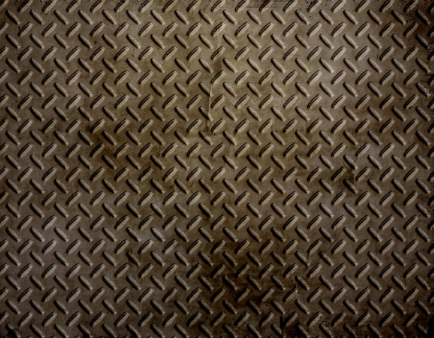 Diamond plate background with a grunge effect