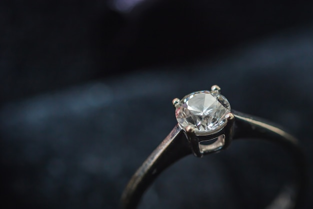 Diamond ring in blurred background.