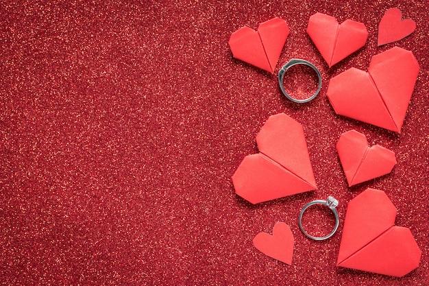Diamond ring on red glitter texture