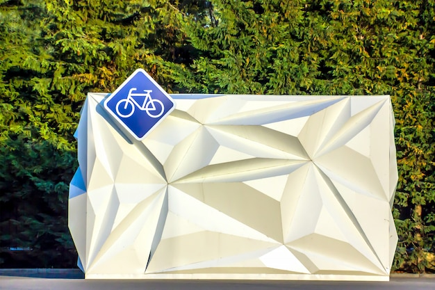Diamond-shaped bicycle sign hanging on a bicycle rental booth