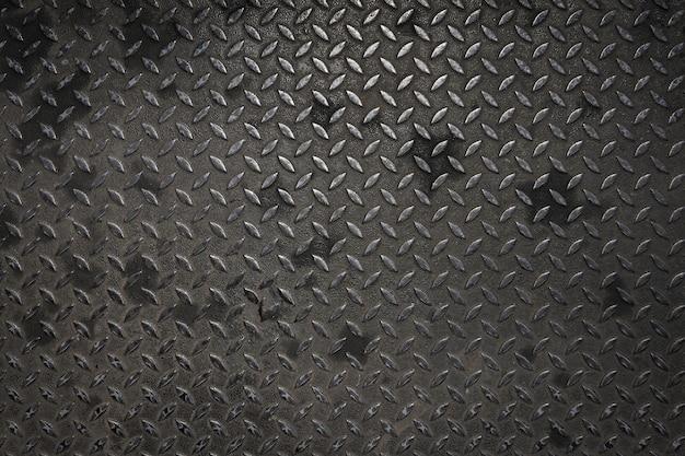 Diamond steel plate with rust texture background dark tone.