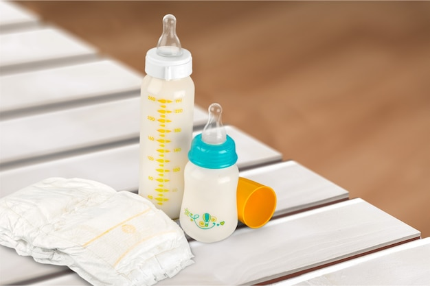 Diaper, baby bottles with milk