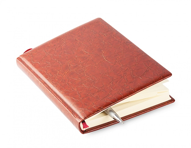 Diary with a brown leather cover and pen