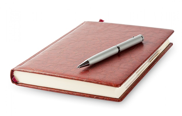 Diary with a pen lying on it