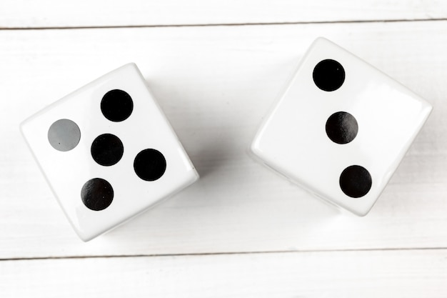 Dice against wooden background