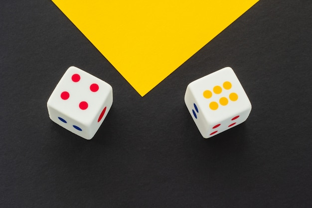Dice on a black and yellow background