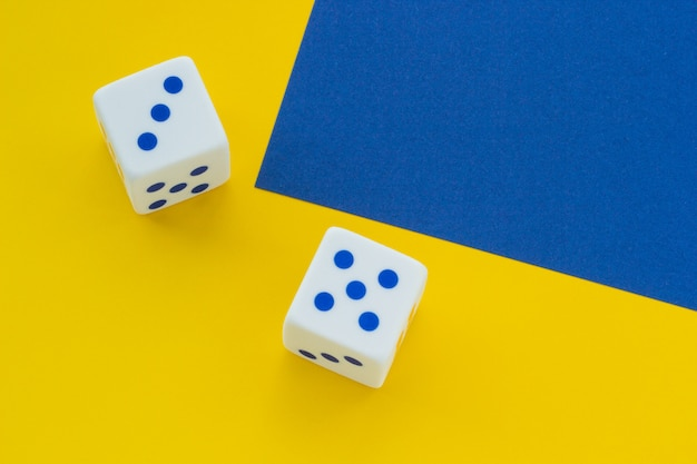 Dice on a blue and yellow background, close-up