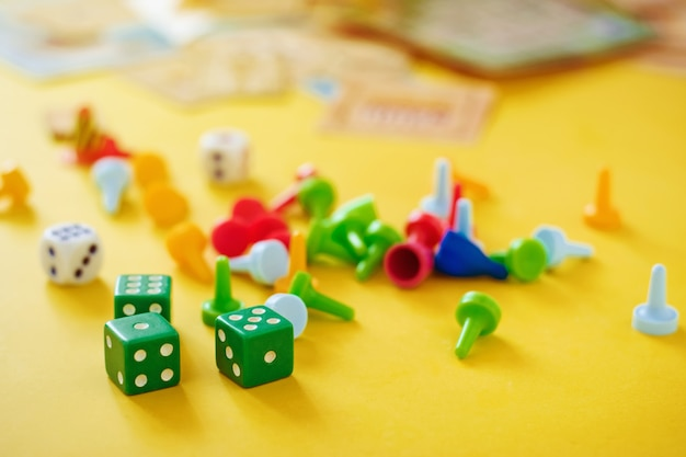 Dice, chips and cards on a yellow background