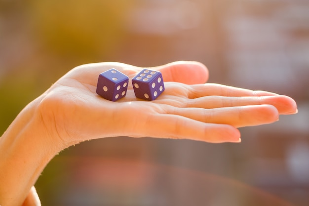 Dice in the female hand.