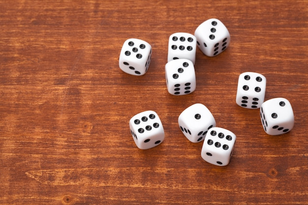 Dice on wooden table.   casino games.