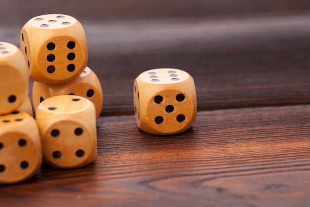 Dice on wooden table. for casino games.