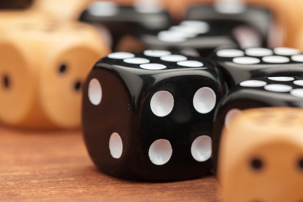 Dice on a wooden table. concept for business risk.