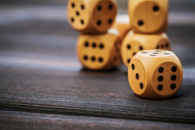 Dice on wooden table.