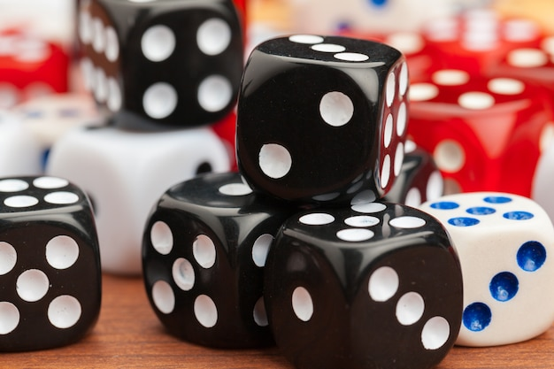 Dice on a wooden table.
