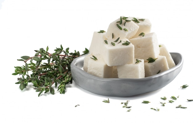 Diced soft cheese isolated