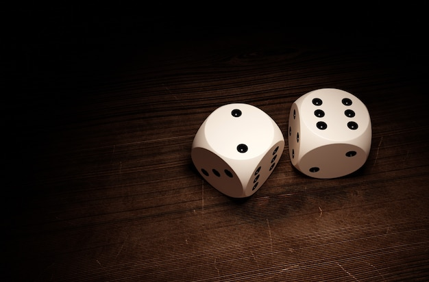 Dices on a wooden surface.