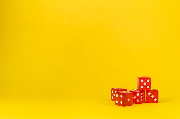 Dices on yellow background