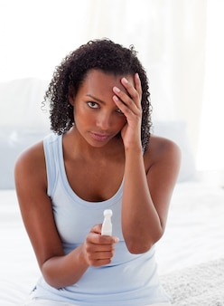 Diconcerted woman finding out results of a pregnancy test