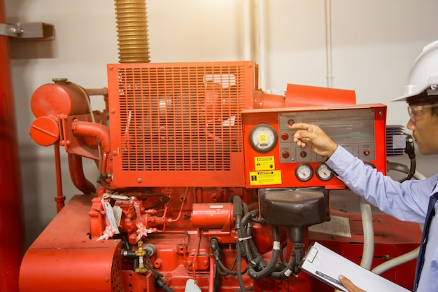 Diesel generator for fire control system red piping and valve.